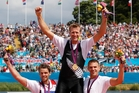 Mahe Drysdale is hoisted by the silver and bronze medallists after winning gold in London. Picture / Mark Mitchell