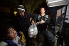 Judi Adams helps with handing out free hot food in Manurewa to those in need. Photo / Dean Purcell