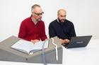 Alexander Turnbull Library curator Paul Diamond, left, and researcher Mat Mullany look through the issues of the niupepa (Maori Language newspaper), Te Waka Maori o Ahuriri on the Papers Past website.
