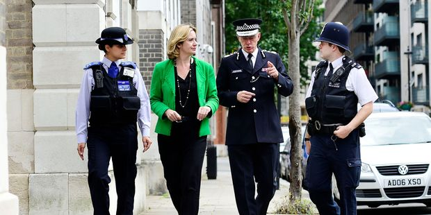 London's Metropolitan Police Commissioner, Sir Bernard Hogan-Howe (second right), wrote an important article for the  Mail on Sunday  this week. Photo / Getty Images