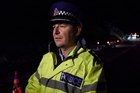 Western Bay police area commander Inspector Clifford Paxton at the crash scene on Tuesday night. Photo / George Novak