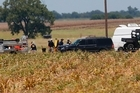 First responders and investigators appear at a scene of a balloon crash that reports indicate took the lives of 16 people near Maxwell, Texas. Photo/AP