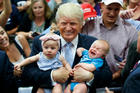Last week Donald Trump caused three-month-old Kellen Campbell to cry. Photo / AP