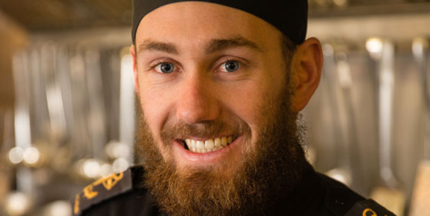 Royal New Zealand Navy Chef Leading Seaman Daniel Chatterton in the galley onboard HMAS Canberra. Photo/Supplied
