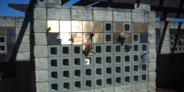 Approximately 20 bronze plaques were stolen from Paparoa Howick Cemetery. Photo / Supplied via Auckland Council