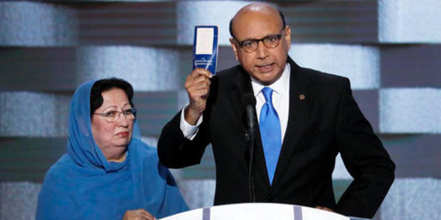 Loading Khizr Khan, father of fallen US Army Capt. Humayun Khan holds up a copy of the Constitution of the United States as his wife listens. Photo / AP