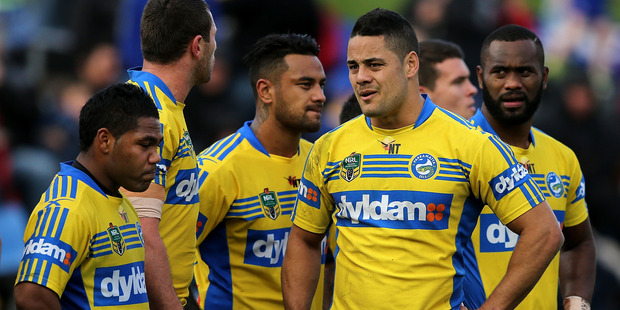 Loading Eels teamates looking dejected during the 2014 match against Newcastle. Photo / Getty Images