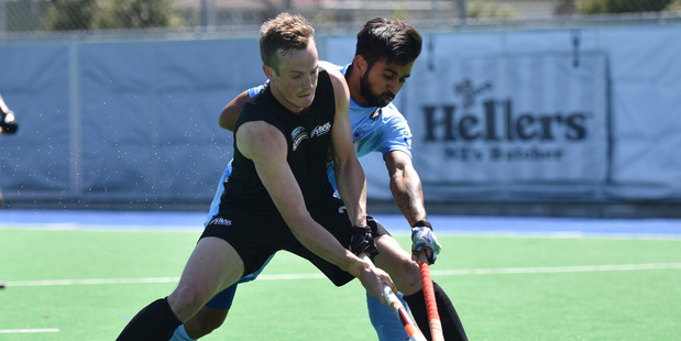 Hugo Inglis controls the ball from Manpreet Singh of India. Photo / Getty Images