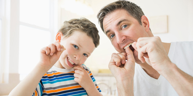 Father and son floss their teeth - but do they really need to?