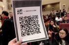 A picture shows the QR code for an organised WeChat group. Photo / Getty Images