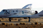 Virgin Galactic's SpaceShipTwo, the world's first commercial spaceline, lands at Moojave airport after a successful flight. Photo / Getty Images