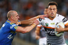 Luke Brooks of the Tigers fends off Jeff Robson of the Eels during the Tigers' 23-8 win over the Eels in Sydney last night. Photo / Getty Images