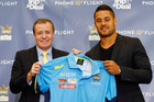 Jarryd Hayne and Titans boss Graham Annesley during a press conference. Photo / Getty