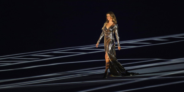 Supermodel Gisele Bündchen walks as The Girl From Ipanema during the Bossa segment during the Opening Ceremony. Photo / Getty Images