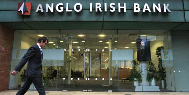 People walk past a branch of an Anglo Irish Bank in Belfast, Northern Ireland. Photo / Getty Images