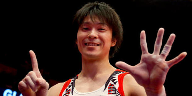 Gymnast Kohei Uchimura needs to read up on roaming charges. Photo / AP