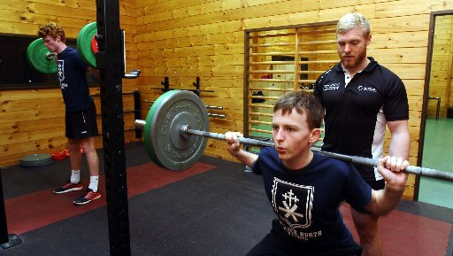 Robert Gillet-Jackson, trainer for the first schools programme of AUT Millennium physical sessions, teaches Havelock North High School students Mitchell Keip (left) and Jack Francois strength technique development. Photo / Paul Taylor