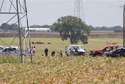 Investigators surround the scene in a field near Lockhart, Texas where a hot air balloon carrying at least 16 people appears to have collided with power lines. Photo / AP