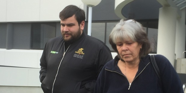 Former volunteer firefighter Bradley Taylor leaves the Hamilton District Court with his mother after admitting responsibility for four bomb hoax incidents in Hamilton last year. Photo / Belinda Feek