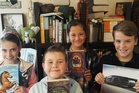 BOOKWORMS: My little ones with their holiday reading from the library. Amelia, Sol, Rhylee and Ethan.
