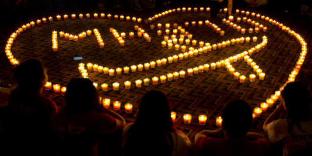 Relatives of Chinese passengers onboard Malaysia Airlines Flight 370 hold a candlelight vigil for their loved ones in Beijing in 2014. Photo / AP