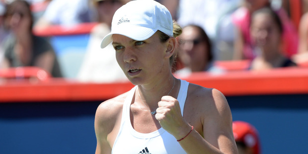 Romania's Simona Halep reacts after winning a point against Madison Keys. Photo / AP