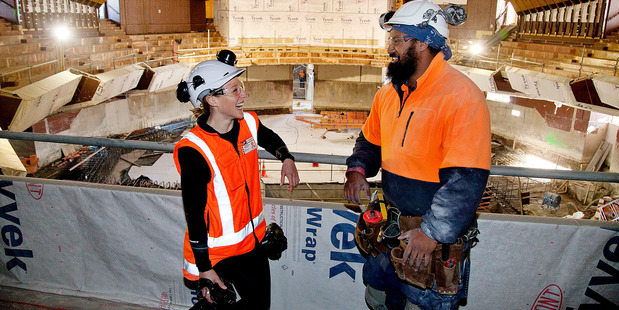 Olivia Spencer-Bower and apprentice carpenter Yannich Noa Siaosi are two people involved in making history at the Town Hall. Photo / Christchurch Star