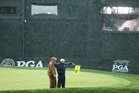 Members of the grounds crew stand on the 18th green during a weather delay in the third round of the PGA Championship. Photo / AP