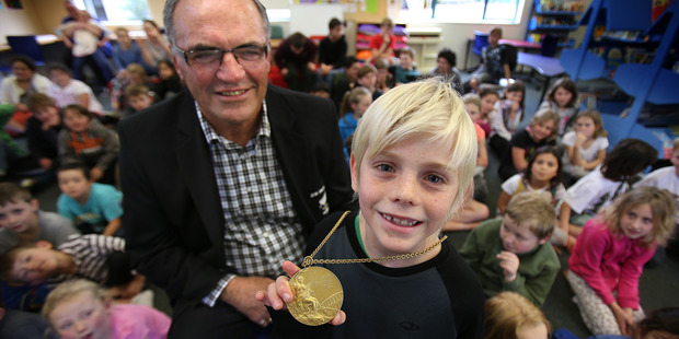 Loading Olympian Gary Robertson, who won gold at the Munich Olympics, did a show and tell with medals at Kaimai School. Will Syme, 8, got to see gold up close. Photo/John Borren