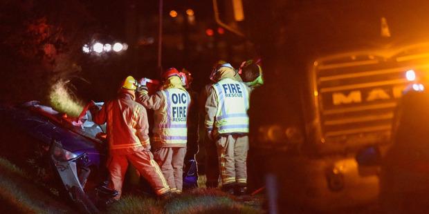 Emergency services attend the scene of a fatal crash near Katikati on Dawson Rd off State Highway 2. Photo / George Novak