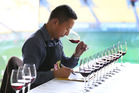 Sam Kim, of Auckland, during judging for the 2016 New World Wine Awards at Westpac Stadium in Wellington. Photo / Mark Mitchell