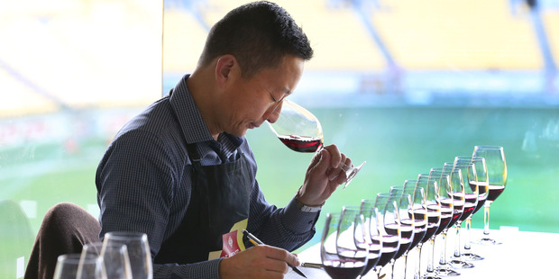 Loading Sam Kim, of Auckland, during judging for the 2016 New World Wine Awards at Westpac Stadium in Wellington. Photo / Mark Mitchell
