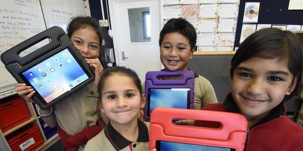 Loading Five Tauranga schools are set to receive Ipads and chromebooks. L-R Front: Nisha Singh, 7, Wairaka Ormsby, 8, L-R Back: Aria Hatakeyama, 9 and Cleo Tamariku Tangohau, 7. PHOTO/GEORGE NOVAK