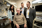 Vandana Sing Orl with head and neck surgeon Dr Andrew Cho and plastic and reconstructive surgeon Zachary Moaveni (R) who have done NZ's first reconstructive jaw surgery on patient Jack Goodall.