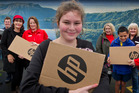 TECHNOLOGY: Shannon Robinson, 18 (front) held up a new technology resource, along with fellow students and staff from Kea St Specialist School, The Warehouse Rotorua and Variety. PHOTO/STEPHEN PARKER