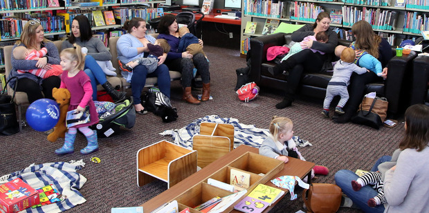 Mothers breastfeed their babies at Whanganui's Davis Library. Photograph by Stuart Munro