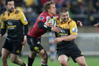 Hurricanes captain Dane Coles makes another break during the Super Rugby final victory against the Lions. Photo /  Mark Mitchell