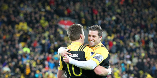 Hurricanes' Beauden Barrett celebrates his first half try with Hurricanes' Cory Jane during the Super Rugby semi-final against the Chiefs. Photo / Mark Mitchell