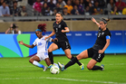 Football Fern's captain Abby Erceg looks to take possession of the ball in their opening Rio Olympics group match against USA. Photo/Photosport.nz