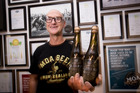 Moa Boss Geoff Ross with the new special Gold beer they have released for the Olympics. Photo / Dean Purcell
