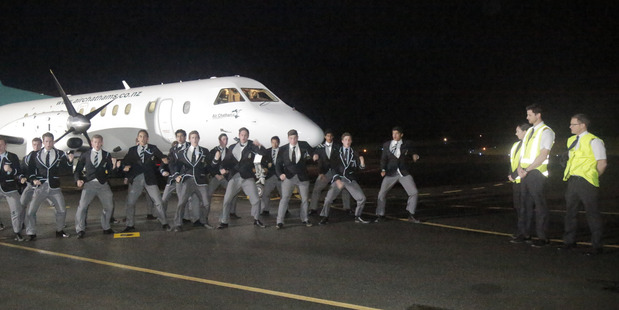 Wanganui Collegiate 1st XV give a haka to Air Chathams' staff arriving on the Saab 340 on Saturday night. PHOTO/BEVAN CONLEY