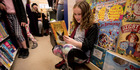 Tabitha Sellar, 8, from Herne Bay gets her hands on the latest Harry Potter book from Dorothy Butler Children's Bookshop in Ponsonby. Photo / Dean Purcell