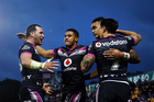 Ken Maumalo of the Warriors is congratulated by teammates Bodene Thompson, David Fusitu'a and Shaun Johnson after scoring a try. Photo / Getty Images.