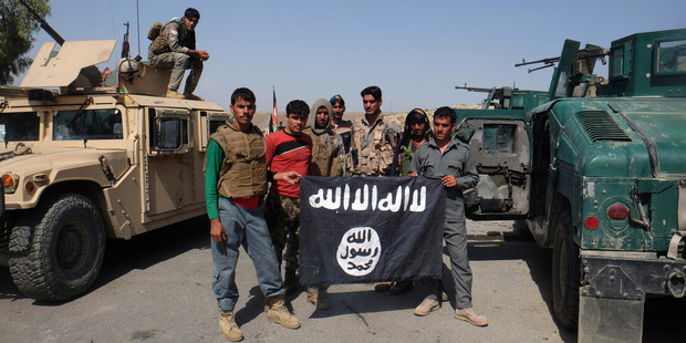 """Entitled """"Break the cross"""", the entire edition of Dabiq focuses solely on inciting attacks on Christians. Photo / AP"""