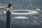 The Christ the Redeemer statue stands above Maracana stadium in Rio de Janeiro. Photo / AP