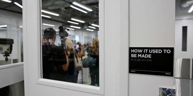 Media make their way into a lab room called 'How It Used To Be Made' during a tour of Area 404, the hardware R & D lab, at Facebook HQ. Photo / AP
