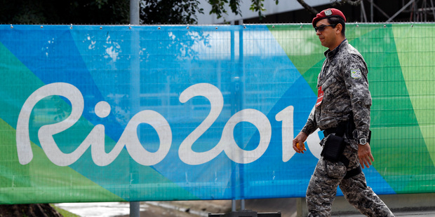 A soldier walks past a security fence outside the boxing arena as preparations continue for the 2016 Summer Olympics in Rio de Janeiro. Photo / AP