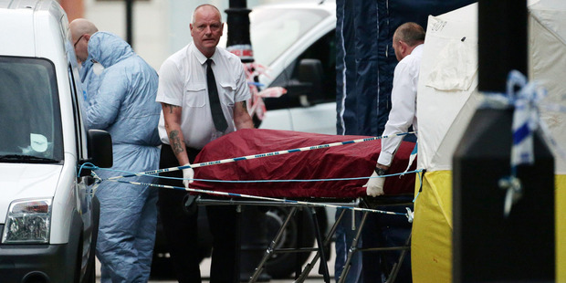 Loading A body is removed from the scene in Russell Square in central London, after the knife attack yesterday. Photo / AP