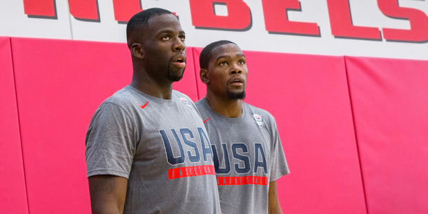 New Golden State Warriors teammates Draymond Green, left, and Kevin Durant work through shooting drills during Team USA basketball practice. Photo / AP.