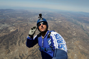 Skydiver Luke Aikins signals to pilot Aaron Fitzgerald as he prepares to jump from a helicopter. Photo / AP